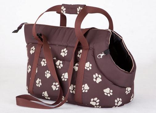 bolso transportín marrón con huellas